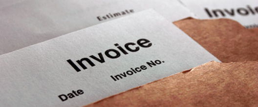 "Letter saying ""invoice"" on it"