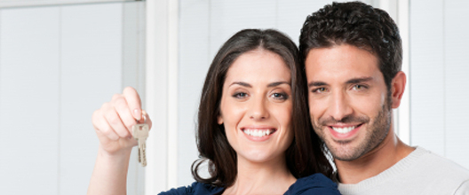 Couple holding a house key